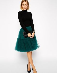 The Perfect Holiday look! Simple black turtle neck and a party tulle skirt.