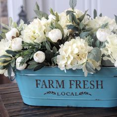 Love this blue, rustic container. Makes the perfect centerpiece. #RusticLandscape