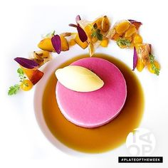 Want the recipe for this cool summer dessert? Visit our website now (link in profile)... #PlateOfTheWeek Peach bavarian, mango mint gelato, and black tea consommé by chef Riccardo Menicucci of @acquerellosf #TheArtOfPlating
