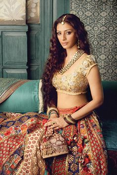 Colorful lehenga and neat single colored gold puff blouse.- loved and pinned by www.omved.com