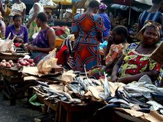 Fish and chicken are on offer at the colorful Dantokpa market in Cotonou, Benin.