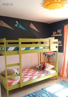 Love the combo of navy walls with chartreuse bunks & coral accents!!