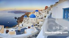 White houses and blue domes of the churches dominate the Aegean Sea, Oia…