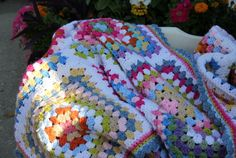 """It's done ! 77"""" by 107"""" of granny squares..5 squares across, 7 squares down..Its so happy looking ! 11 rounds in each square , then crochete..."""