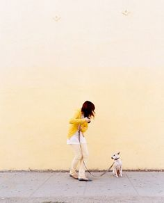 Photograph by Brigitte Sire: hello cute photo of girl and dog