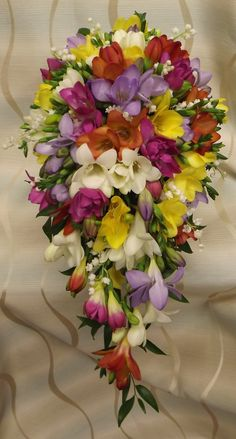 absoultely stunning mixed freesia and lily of the valley shower bouquet  www.weddingflowersbylaura.com Freesia Wedding Bouquet, Bridal Bouquets, Wedding Flowers, Bouquet Images, Budget Bride, Lily Of The Valley, Different Styles, Color Mixing, Floral Wreath