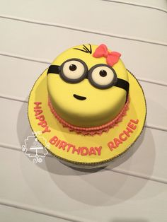 A special lil minion inspired 2nd birthday cake for a special lil baby girl by Lil Mrs Cake Heart. Www.facebook.com/lilmrscakeheart