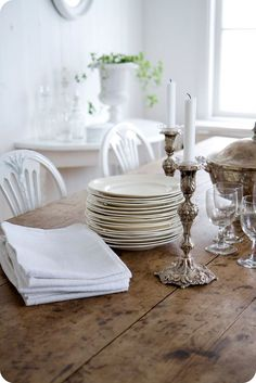 White plates and sterling silver