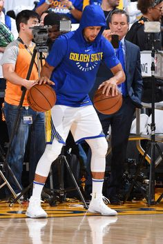Stephen Curry of the Golden State Warriors warms up before the game against the Houston Rockets on October 17 2017 at ORACLE Arena in Oakland...