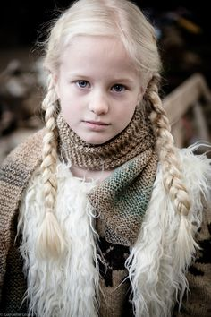 Stronger than she seems, more witty than many of the men along on the voyage.  Years above her age and a bit of a know it all.