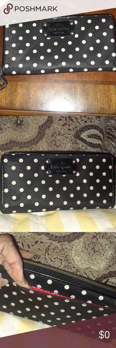 Polka Dot Wallet Lovely Kate Spade Zip Wallet is so roomy! Kate Spade New York Tag inside wallet, and stamped in gold on the leather inside of wallet as well. Black/White Polka Dot Pattern, With Red Signature lining.  12 card slots and 5 slip areas. Center zip pocket for change. Our side slip pocket. In excellent loved condition. Outside zipper pull has been replaced due to normal wear. Appx 7.5 x 4 x .50. kate spade Bags Wallets
