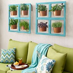 Create a miniature herb garden in the buckets hanging from a space-saving frame.
