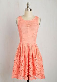 Shake up the criteria for wardrobe staple, leading your campaign with this coral pink A-line!