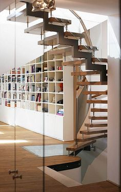 love the spiral staircase and the library.  will have one going to the loft instead of to a basement.