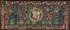 Created in Bruges in the 2nd quarter of the 16th century: a millefleurs tapestry with armorials (169 x 390 cm) from the collection of De Wit Fine Tapestries. Millefleur refers to many small flowers and plants in the background. A popular motif in French and Flemish tapestry in that time.