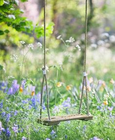 Tree swing in the flowers! Violet needs this!
