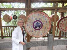 I am standing by the gong of prosperity by the entrance to the Reed Flute Cave, near Guilin, China. The cave, with stalactites and stalagmites is over 18 million years old-writing inside the cave dates back to Guilin, China Travel, Flute, Dates, Entrance, Writing, Entryway, Door Entry, Date