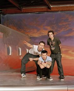 I love everything about this picture. The way Travis is standing, the look on Mark's face. And just Tom <3