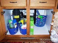 Dollar Store Tubs for under the sink.. 1 bucket for cleaning products for each area.. I like it! :)