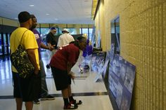 Former Catamount student-athletes checking out the display.
