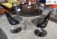 Chrome, lucite and smoked glass dining table and tulip base chairs. Available at Mid Mod Collective. Email midmodcollective@gmail.com for more info. SOLD!