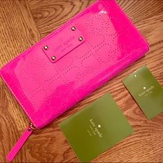 """kate spade New York Metro Spade Wallet. NWT kate spade neda wallet, metro spade print in hot pink / """"pinksphre"""".                              -perforated spade vinyl -large zip around continental wallet -14-karat light gold plated hardware -leather and custom woven lining -ksny blind embossed signature on license plate -12 credit card slots, 3 billfolds, and zipper change pocket; exterior slide pocket -4.0''h x 7.6''w x 0.8''d kate spade Bags Wallets"""