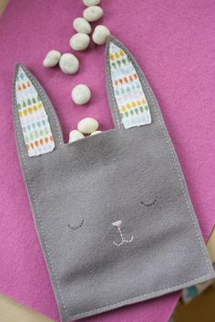"""I saw this pin pop up all over the place yesterday, which led me to Mer Mag's """"Easy Bunny Candy Pouch"""" - and before I knew it I had some felt bunny pouches of my own. It was exactly the kind of pro..."""