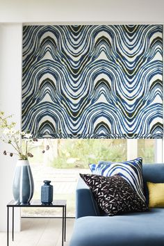 A swirling black and white zebra print fabric with hints of pale blue making a statement Roman blind. An iconic print from our Livingetc collection, this bold, monochrome print is sure to be a highlight in your living room. The print has an ink-wash appearance, with the rich black stripes fading at the outer edges to a soft pale blue. View our Livingetc Kovu Batick Roman Blind. Blinds For You, Blinds For Windows, Cheap Roman Blinds, Fabric Blinds, Curtains, Office Blinds, Types Of Blinds, Living Etc, House Blinds