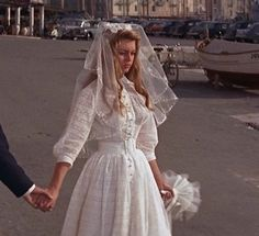 Brigitte Bardot's simple but lovely wedding dress in And God Created Woman. Love how it's apparent modesty is accompanied by the sheer fabric and glimpses of skin… Brigitte Bardot, Bridget Bardot, Bardot Wedding Dress, And God Created Woman, Wedding Movies, Hollywood Glamour, Celebrity Weddings, Marilyn Monroe, Wedding Gowns