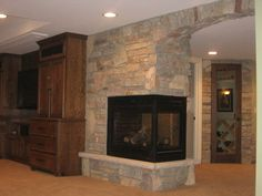 stone wrapped three sided fireplace
