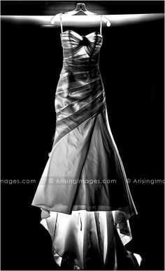 Love this black and white shot of this awesome wedding dress! Very artistic and beautiful.