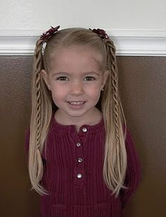 ponytails with twisted braids-I think this would look cute on my nieces once they gets older and their hair is longer!