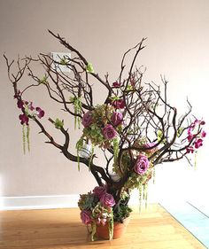 Over the top, purple and green, suspended globes on manzanita branches, black accents, moss