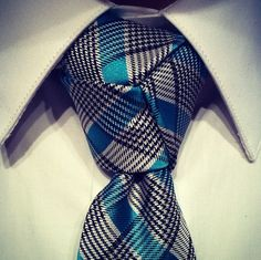 Trinity knot. Learn how to do one, and where to do one @Blacklapel.com keep him fitted.
