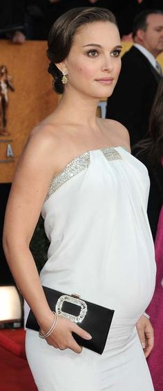 Natalie Portman's style when pregnant..elegant & stylish...perfect clutch..just enough bling...