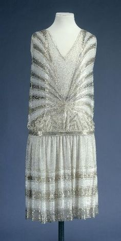 Dance dress, 1926. White cotton tulle embroidered with tubes  beads.