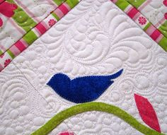 This is a bed runner, but I would use it as a table runner.