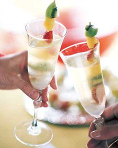 Sip on this bubbly tropical teaser this holiday. For more holiday drinks: http://www.bhg.com/christmas/recipes/top-holiday-drinks/?socsrc=bhgpin122413champagnepunch&page=5
