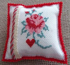 Oh look, Amy at 'love made my home' has already made the Mollie Makes rose cross stitch into a very pretty pin cushion! Inspired :)