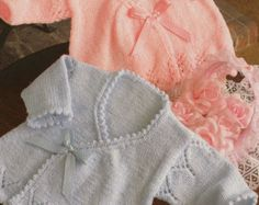 This item is a PDF file of the knitting pattern for these gorgeous baby items.    Lovely nautical cardigans and sweater design.    The pattern will be available for download upon receipt of payment, for you to print out or read from your computer.    The pattern calls for double knitting yarn and 3.25 and 4mm needles..