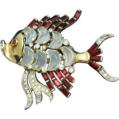 Gorgeous and seldom seen vintage 1950 Crown Trifari demi lune faux ruby baguette fish figural brooch or pin. This magnificent pin was designed by