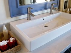 Undermount long sink with two faucets. Nice solution for small ...