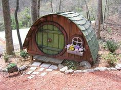 Large Fairy House This one appears to be nearly playhouse size. It also might be more of a Hobbit house than a Fairy house, but regardless it's cute as it can be. Fairy Garden Houses, Gnome Garden, Fairy Gardens, Miniature Gardens, Hobbit Hole, The Hobbit, Dog Houses, Play Houses, Small Houses