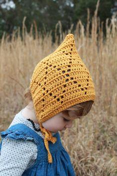 bonnets Ravelry: Monroe Pixie Bonnet pattern by Mel Harrison Crochet Baby Bonnet, Crochet Bebe, Crochet Baby Clothes, Cute Crochet, Crochet For Kids, Crochet Crafts, Knit Crochet, Pattern Baby, Baby Patterns