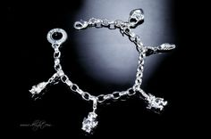 Alloy + 925 Sterling Silver + High Quality Polishing + Durable Colour Protector 5 charms Lobster clasp  * Size: Adjustable length  * Measurements : 21.5cm  * Weight (g): 28 * ATBR024-1 * www.i-delight.com