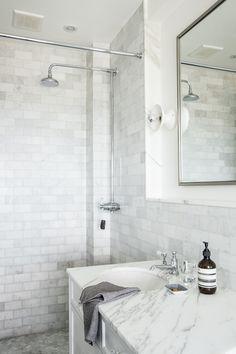 Contemporary Traditional Bathroom: A sleek rain shower in a minimalist master bathroom.