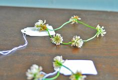 making clover necklaces in the summer time.