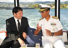PEARL HARBOR (July 2, 2013) Japanese Defense Minister Itsunori Onodera listens while Adm. Cecil D. Haney, commander of the U.S. Pacific Fleet, explains the improvements to the U.S. submarine fleet before a wreath laying ceremony on the USS Arizona Memorial. (U.S. Navy photo by Mass Communication Specialist 2nd Class David Kolmel/Released)