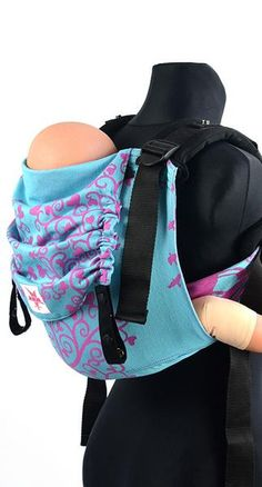 KOKADI ONBU – ERNA IN WONDERLAND The Kokadi Onbu is one of the most trusted buckle baby carriers available on the market, regarded highly in Australia and aroun