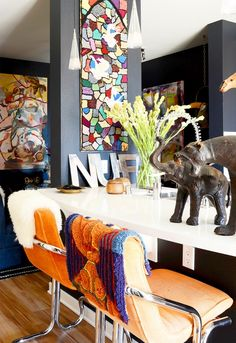Home Tour: Erica Reitman's Boho Apartment via @domainehome Don't like everything. It's to much. But those elephants! and those chairs!
